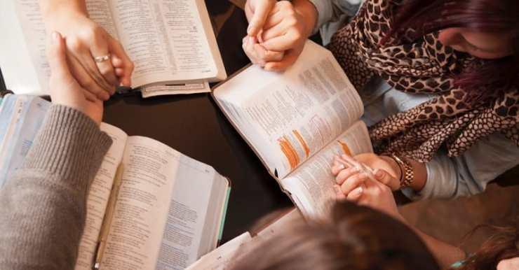 12793-hands-pray-bible-study-group-women.800w.tn_