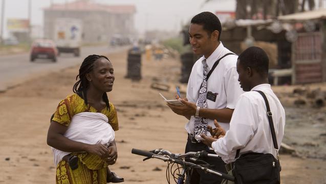 missionaries-teaching-black-woman